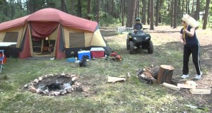 camping with my parents(cuting wood for camp fire and riding my quad,racing my dogs).mpg