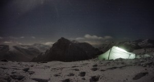 Winter wild camping on a snowy Glencoe mountain top